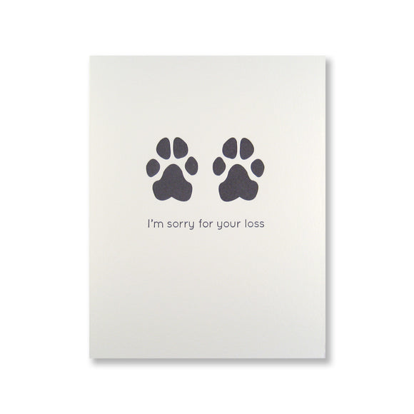 Letterpress pet sympathy card of dog paw prints and