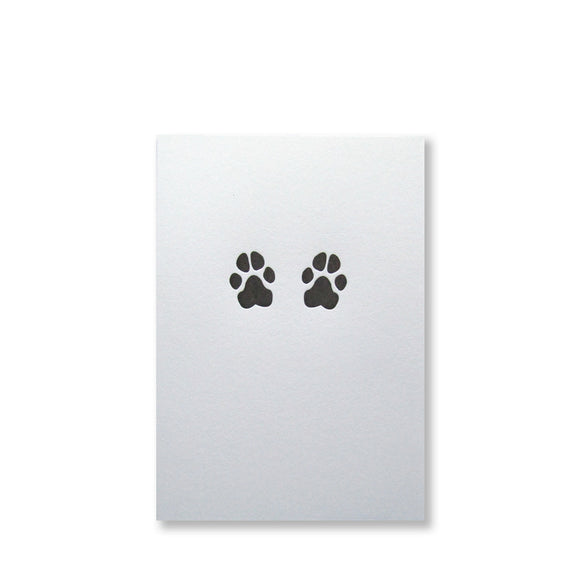 Letterpress dog paws folded note cards in black ink by inviting letterpress in austin texas.