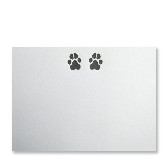 Letterpress dog paw stationery in black ink by inviting letterpress in austin texas.