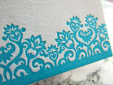 Letterpress floral flat stationery in turquoise ink with orange envelopes, by inviting in Austin, Texas.