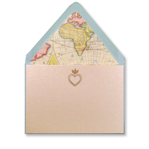 Letterpress gold heart milagro on pearlized cards with atlas-lined blue envelopes, by inviting in austin, texas.