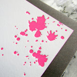 Letterpress blood splatters stationery, shown in neon ink on white cards, by inviting letterpress in Austin, Texas