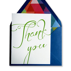 Letterpress thank you cards printed in greenery spring green ink and paired with lined, royal blue envelopes, printed by inviting letterpress in austin texas.