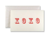 Letterpress Valentine's Day card, red XOXO on white card with white glassine envelopes, designed & printed by inviting in Austin TX.