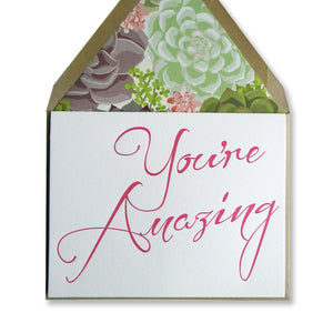 Letterpress card for your amazing friend, you're amazing is printed in fuchsia ink, with brown envelopes lined with succulents, by inviting in austin texas