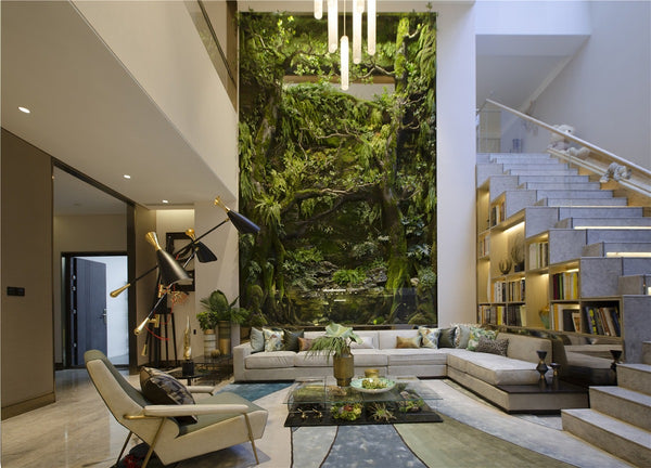 """Green Living Room"" by Charly W. Karl, with terrariums in the coffee table and within the large green wall. via greenroofs.com"
