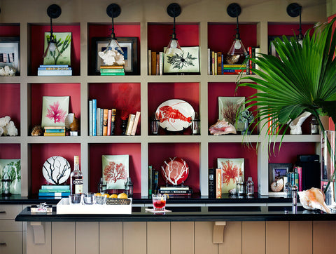 A rosy red hue sets the tone for the room from lonny.com