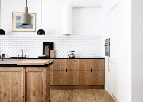 Subway tile and cut out pulls. Image via @remodelista
