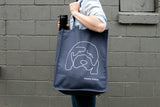 "Hannah Gadsby ""Douglas"" tote bag on live model."