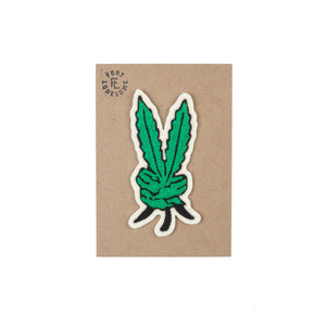 cross stitched weed leaf patch in the shape of a persons hand holding up a peace sign