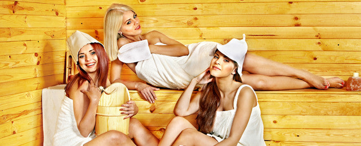 Women with sauna accessories