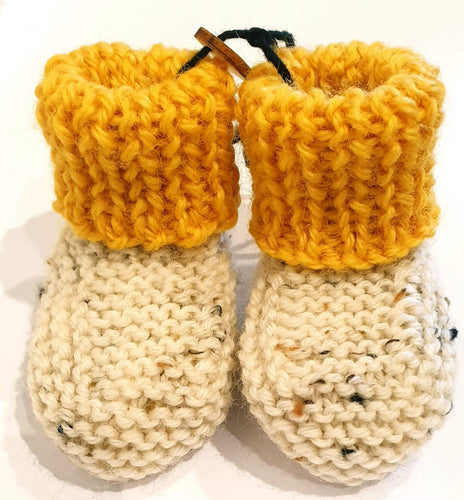 Cream hand knitted baby boots with yellow cuff - birth to 6 months - Nikki Dellavia