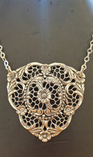 Load image into Gallery viewer, an intricate silver pendant