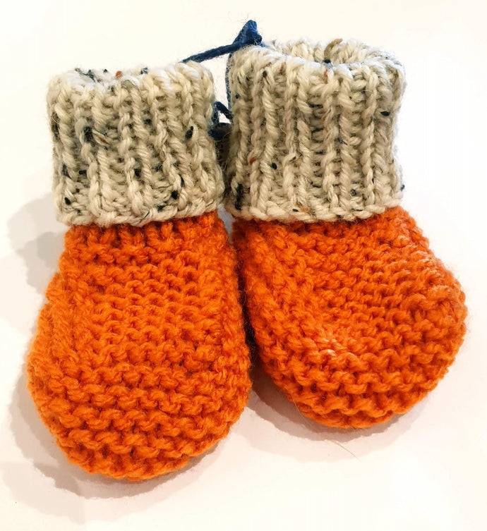 Burnt orange hand knitted baby boots with cream fleck cuff - birth to 6 months - Nikki Dellavia