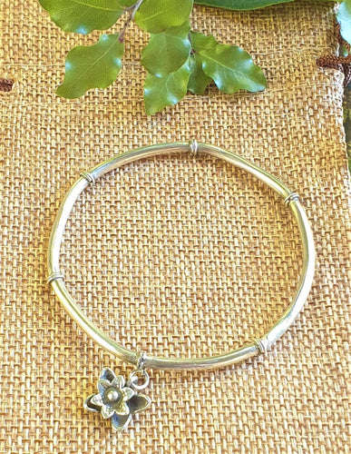 silver bangle with flower dangle