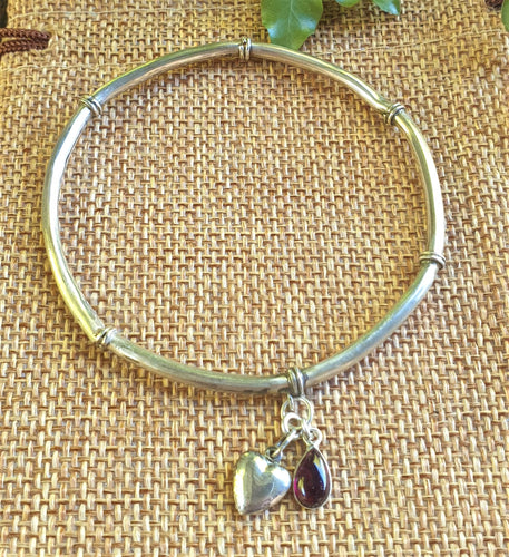 silver bangle with puffy heart and amethyst dangle