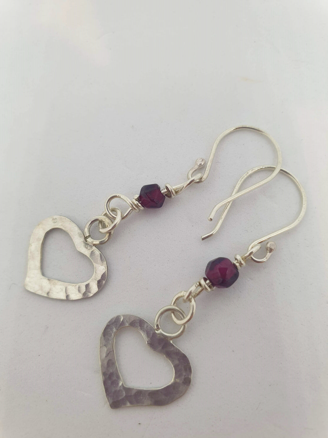 Sterling Silver Hammered Heart and Garnet Earrings by Silver Rose Jewellery-Jewellery-Atelier Crafers