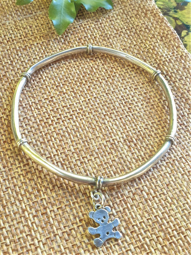 silver bangle with teddy dangle