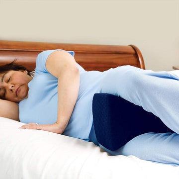 Sleeping positions for back pain relief: On your side with a pillow between your knees