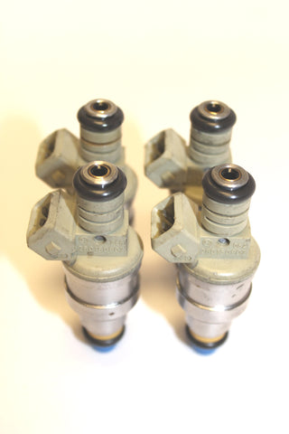 Set of 4 Genuine Bosch 4 Hole Upgrade 14LB 1985 - 1997 Ford Mercury Mazda 1.9L 2.3L Fuel Injectors