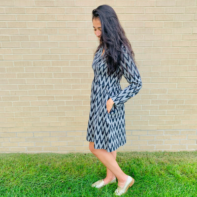 Transition into fall with our button up dress