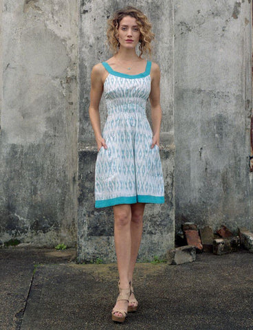 Buy fair trade clothing, such as this XO Blue Dress.