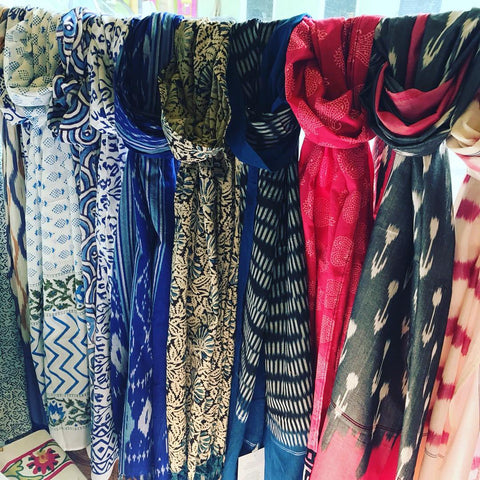 A variety of colorful, lightweight scarves from Passion Lilie that make for great affordable, eco-friendly clothing accessories to update your wardrobe.