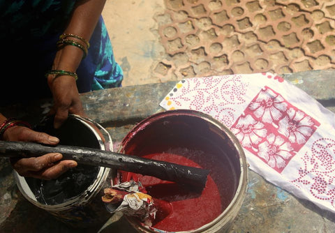 Red and black natural dyes, such as those shown here, are used along with a variety of other colors in Passion Lilie's Indian clothing.