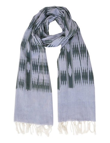 Complete any of your fall outfit ideas with one of our Light Blue and Olive Banded Stripes Scarves, shown here with its light blue color, olive ikat print, and white tassels.