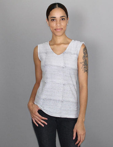 Our Breton Striped Organic Jersey Top, a classic gray-and-white-striped sleeveless blouse, functions as a staple item of affordable, eco-friendly clothing for your wardrobe.