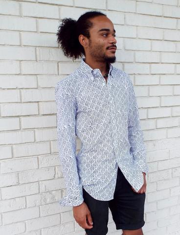 This Classic Tulip Men's Button Down Shirt, which features a unique, black floral print on white and long sleeves, is a great gift for the man who wants easy and comfortable fashion.