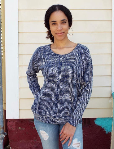 Save 20% on all purchases during our November promotion, including this Dotted Blue Fleece Sweater, featuring uniquely patterned white dots on blue in warm, 100% organic fleece.