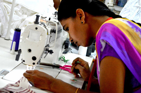 Geetha, the first participant in Passion Lilie's job training program, using a sewing machine.