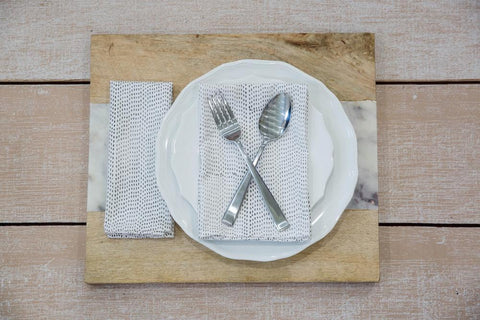Whether you're throwing a sustainable dinner party or just enjoying a quiet meal alone, these Grey Dots Cloth Napkins from Passion Lilie are an easy way to step up your dinner game with sophistication and sustainability.
