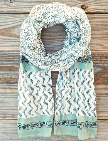 Many teachers are more concerned with helping others than themselves, so consider teacher gift ideas that are a treat just for them, such as this Mint Paisley Scarf from Passion Lilie.