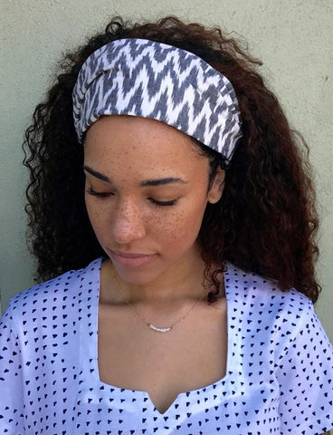 This white-and-gray zigzag Chevron Headband from Passion Lilie is a great accessory for keeping your hair out of your face while still looking stylish at any music festival.