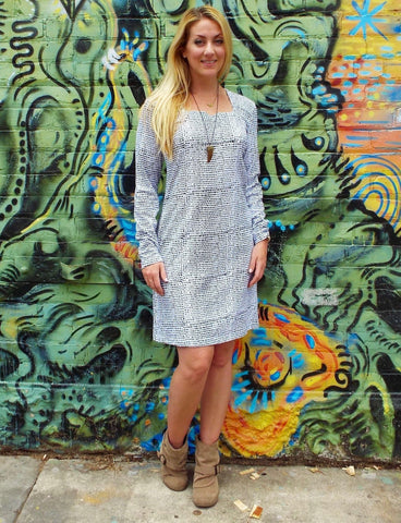 Buy this Ice & Dots Organic Knit Dress, featuring unique hand block printed black dots on white, long sleeves, and a starfish cut-out neckline, for 20% off this November 23rd through 27th.