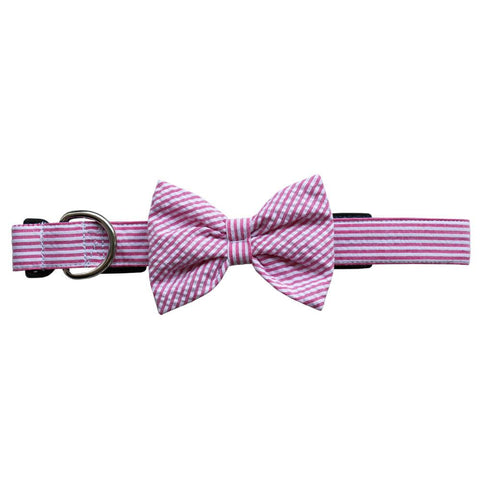 This Seersucker Bow Tie Dog Collar from NOLA Couture features pink and white stripes on its 1-inch collar and attached bow tie.