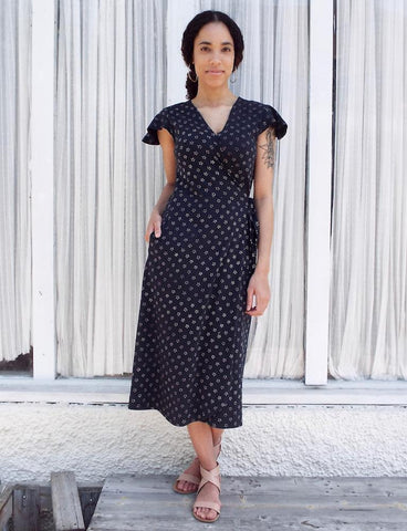 Planning a sustainable dinner party doesn't stop after you procure your ethical food, dishes, utensils, and cloth napkins. Make sure your outfit is just as classy and ethical as the rest of the party with this Navy Stars Organic Jersey Wrap Dress from Passion Lilie.