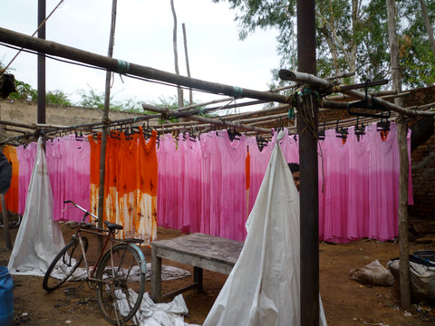 Hand dyed fabrics drying in the sun.