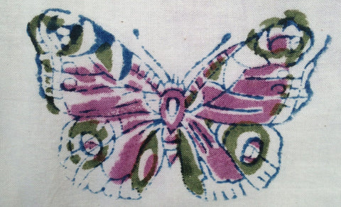 This butterfly print incorporates blue, green, and fuchsia dyes, each of which must go through the hand block printing process individually.