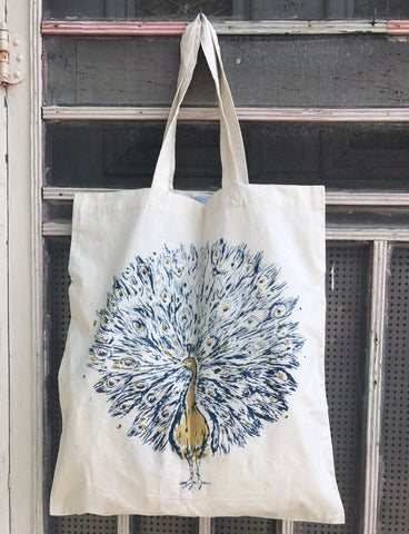 Receive a free tote bag, such as this Peacock Tote, which features an elaborate navy-and-gold peacock, as our gift to you during our November holiday promotion.