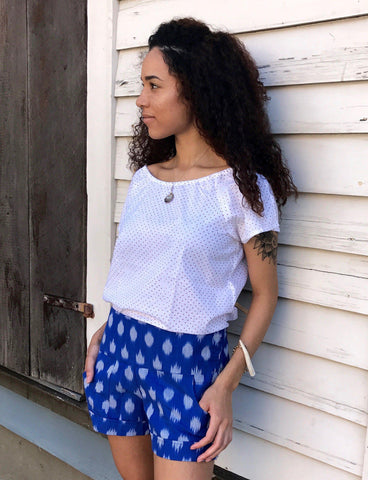 These Playful Blue Shorts from Passion Lilie feature a flat front with elastic in the back and pockets for maximum comfort and style during a music festival.