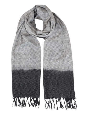 This Grey with Black Timeless Ikat Scarf, featuring a lighter gray in the middle and darker gray with tassels at the ends, is sure to look and feel great on any man, woman, or child in your life this holiday season.