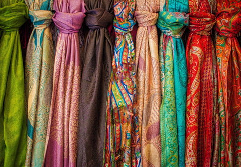 Silk fabrics in a variety of colors and designs, which could have been used to reflect the politics of international trade.