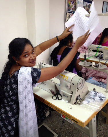 Fair trade stitcher at a sewing cooperative.