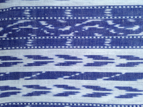 Hand loomed blue fabric.