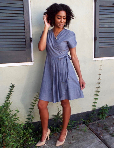 For an office summer outfit that's both fashionable and professional, buy Passion Lilie's Chambray Wrap Dress.