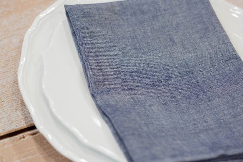 Cloth napkins, such as this Chambray Cloth Napkin from Passion Lilie, are a must when planning a sustainable dinner party.