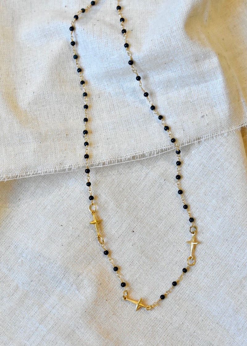 ONYX TRIPLE CROSS NECKLACE